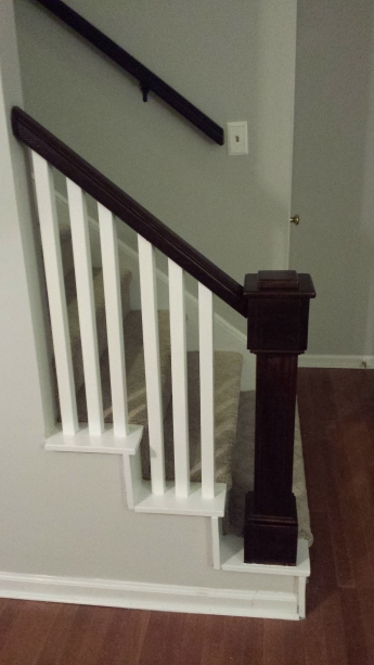 Restained and painted railing