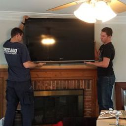 Firemen hang tv